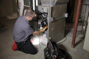 Technician working on heating system