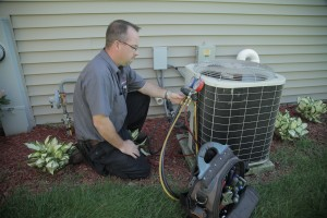 Technician working on air conditioning
