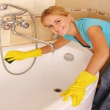 Woman Cleaning Bathtub - Plumbing Fixture Blog Post